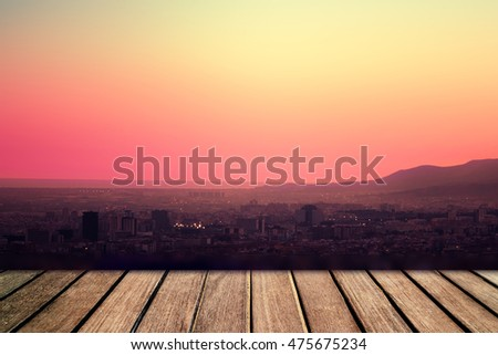 Old wooden planks in front of  sunset sky as background. Vintage plank board with beautiful  sunset