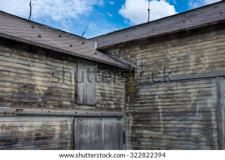 Old wooden planks of weathered wood on this barn in New York State. - stock photo