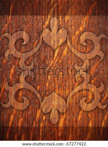 old wooden planks wall with carved ornament