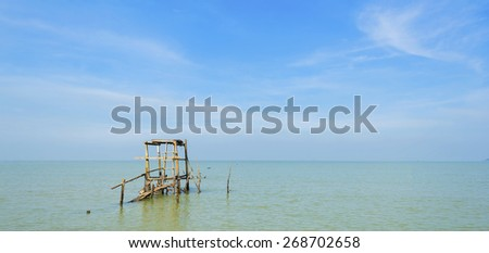 Old wooden platform at sea. - stock photo