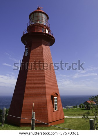 Old wooden red lighthouse