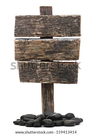 old wooden road sign and stones on white background - stock photo