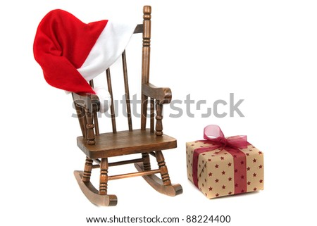 old wooden rocking Chair with red jelly bag cap - stock photo