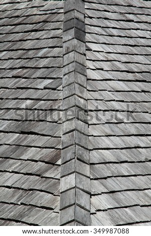 Old wooden roof of hotel resort in forest.