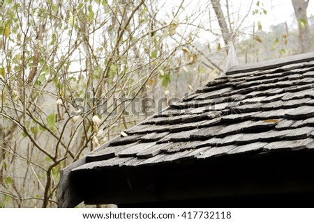 Old wooden roof tiles from thailand - stock photo