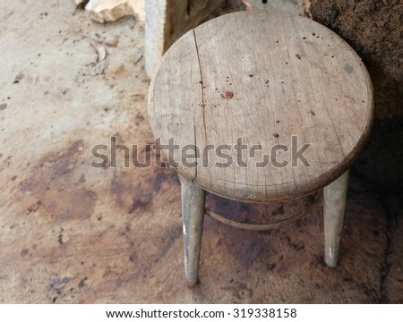 Old wooden round chair with old floor - stock photo