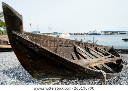 Old wooden row boat on beach