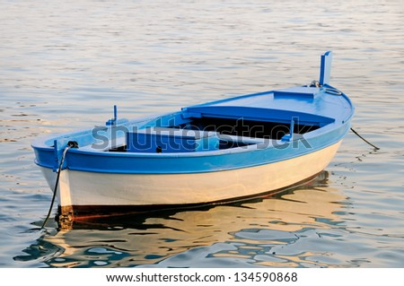 Old wooden rowboat - stock photo