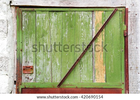old wooden rusty green door background - stock photo