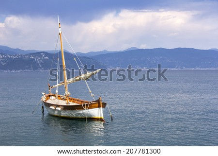 Old wooden sail ship, docked in the port of Portofino, Italy  - stock photo