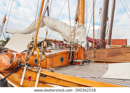 Old wooden sailing boat in the village of Workum in the Dutch province of Friesland - stock photo