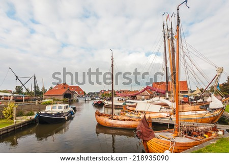 Old wooden sailing boats in the village of Workum in the Dutch province of Friesland - stock photo