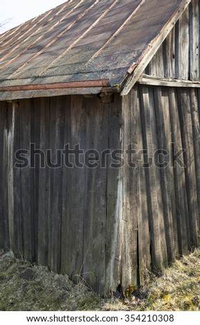 Old wooden shed with tin roof in the Ukrainian village. - stock photo