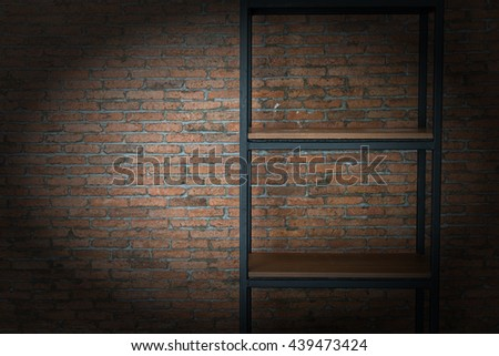 Old wooden shelf over grunge red brick wall background
