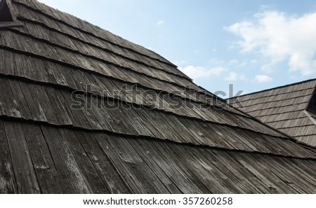Old wooden shingle roof against the sky. Old traditional Ukrainian architecture.