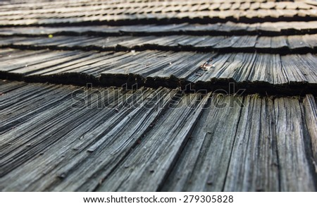 Old wooden shingle roof. Wooden surface texture. - stock photo