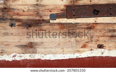 Old wooden ship fragment, hull under renovation, background photo texture - stock photo