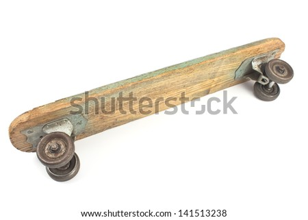 Old wooden skateboard isolated on white - stock photo