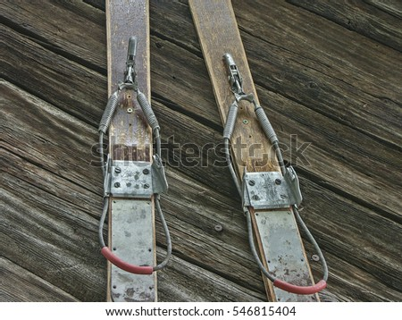 Old wooden skis with rustic cable tie