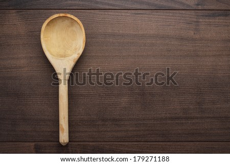 old wooden spoon on the blue table - stock photo