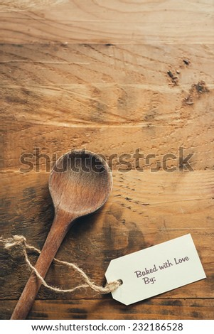 Old wooden spoon with baked with love tag - stock photo