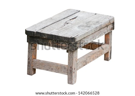 Old wooden stool isolated on white background.