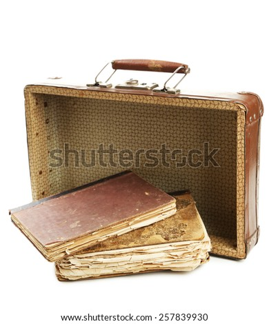 Old wooden suitcase with old books isolated on white - stock photo