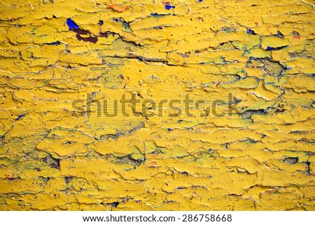 old wooden surface covered with several layers of paint - stock photo
