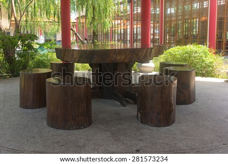 old wooden table and chair made with tree bole. - stock photo