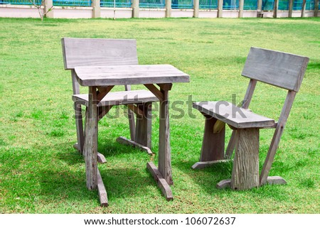 old wooden table and chairs in lawn