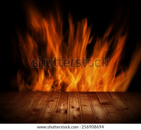 Old wooden table and fireplace - stock photo