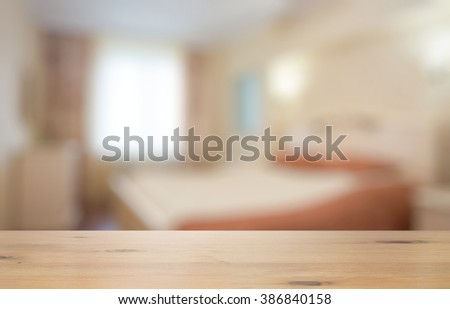 old wooden table in the bedroom - stock photo