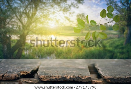 Old wooden table with natural background - stock photo