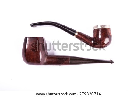 Old wooden tobacco pipes isolated on white background/Old wooden pipes