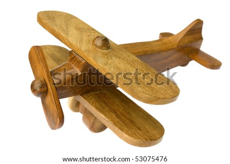 Old wooden toy plane on white background - stock photo