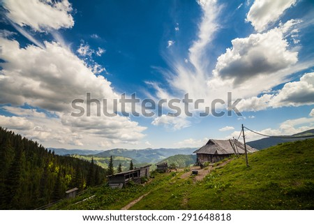 Old wooden traditional house in the mountains. - stock photo
