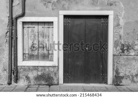 Old, wooden Tuscan door and window (black and white) - stock photo