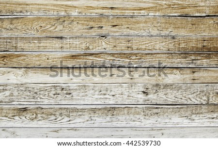 Old wooden wall house construction - stock photo