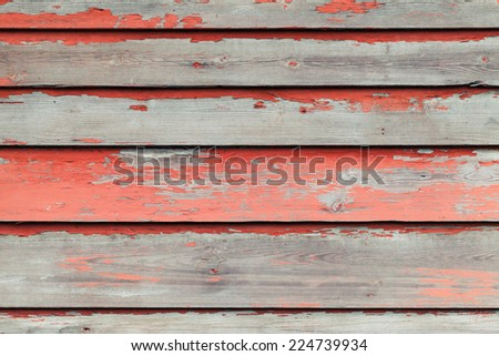 Old wooden wall with red paint, vintage background photo texture - stock photo