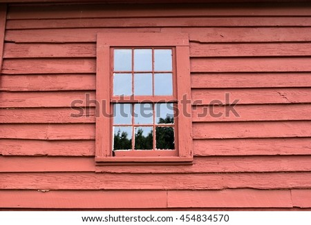 Old wooden wall with window painted red backdrop - stock photo