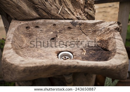 Old wooden wash basin out door.