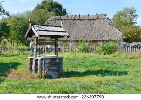 old wooden well in the Ukrainian village - stock photo