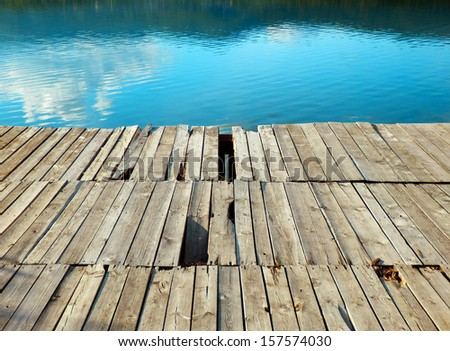 old wooden wharf and lake   - stock photo