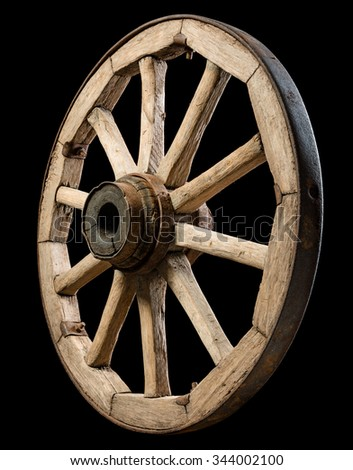 old wooden wheel on black background - stock photo