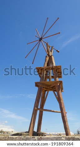 Old wooden windmill against a blue sky on Lanzarote island, Spain - stock photo