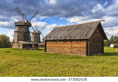 Old wooden windmill and barn in Suzdal town, Russia. Golden Ring of Russia.