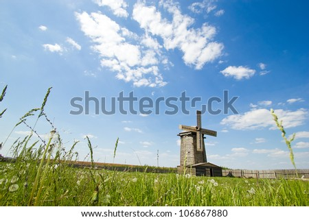 old wooden windmill in russian village