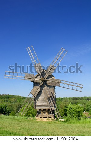 Old wooden windmill in the countryside and blue sky