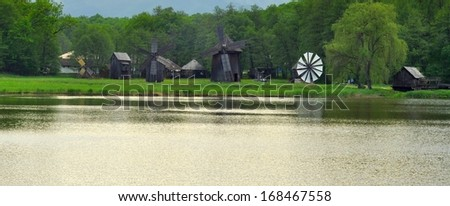 Old wooden windmills, at the ASTRA Ethnographic Museum from Sibiu, Romania - stock photo