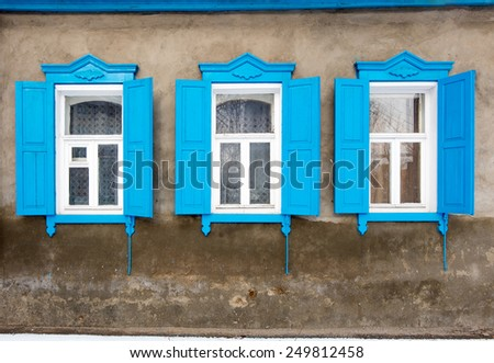 Old wooden window in a stone wall. Astrakhan, Russia. - stock photo